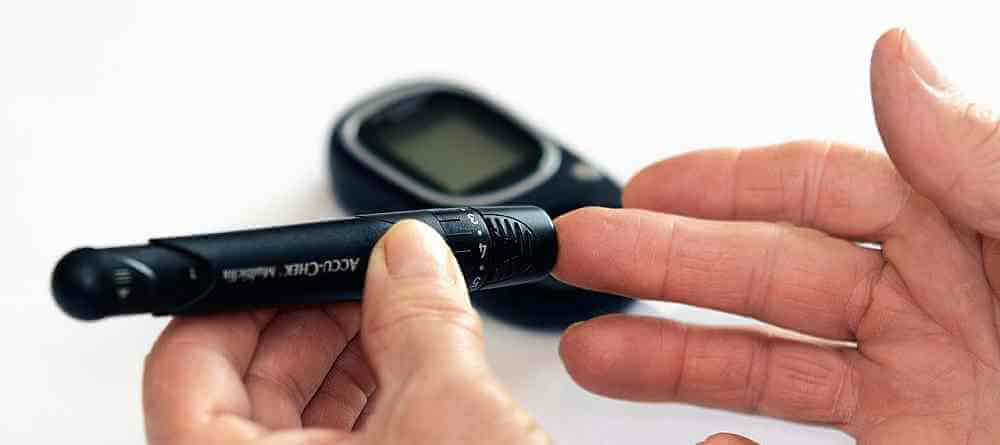 CBD and diabetes - Type 1 diabetes - man checking blood sugar levels
